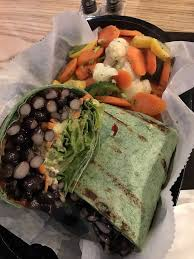black bean and avocado wrap with side veggies huge portion delicious too at