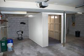 safe room in a basement with lawn mower and lawn equipment