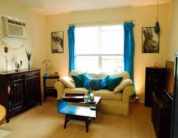 Yellow And Brown Living Room Living Room Yellow Painted Wall With White Leather Cushion Also
