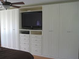 What a good idea to use up the limited space, built in Wardrobe with TV  stand
