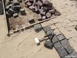 laying granite paving stones