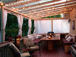lighting a pergola. pergola lights idea hang string and fabric drapes to create a cozy outdoor space lighting l