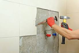 ceramic tile glue from a wall