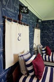 make a monogrammed headboard using canvas for a pirate or nautical themed room boys befroom