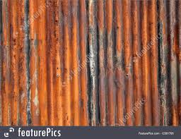 rusty old corrugated iron fence close up