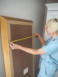 how to perfectly hang a mirror with just a few power tools a jumpsuit and