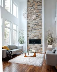 a 20foothigh ceiling is shown off with a ribbon of stonework that reaches upward from the fireplace and airy qualities both moooi pendant light high lighting r63