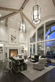 high contrast living room pairs black hardwood flooring with white walls reaching up to a