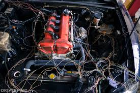 mazda miata 2 4l ecotec swap part 5 wiring harness and electric then remove all of the plastic wiring harness wrap from the harness as you cut out each unnecessary plug you want to trace the wires from that plug back