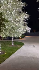 Outside Trees With Lights Kim Kardashian West Shows Off Her All White Nontraditional
