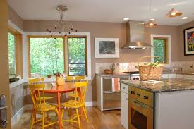 Small Farmhouse Kitchen Ravishing Nickel Chandelier Over Yellow Rounded Small Dining Table
