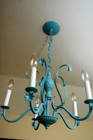 this was the original chandelier that came with our 1960 s house and it was brass and pretty ugly but once i spray painted it teal i fell in love with it