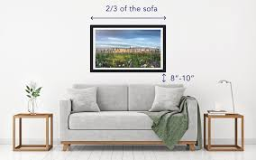 2 simple rules to follow when hanging art above a sofa