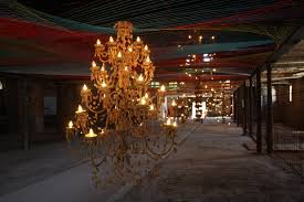 the other room of note is in a smaller separate building filled with strange chandeliers by pae white picture below bottom