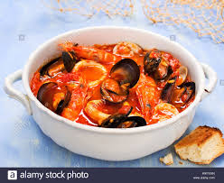 rustic italian seafood soup Stock Photo ...