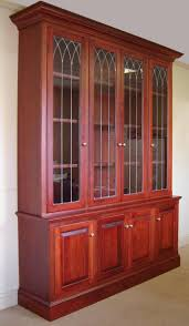 custom made cherry bookcase w leaded glass doors