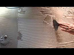 how to remove tile adhesive from