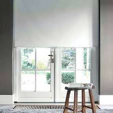 cut to width bright white polyester blackout motorized roller shade in shades solar for sliding glass