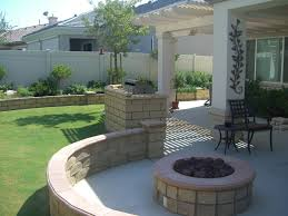 charming backyrad patio decor ideas with round fire pit and curved banquette also iron outdoor chairs plus grilled