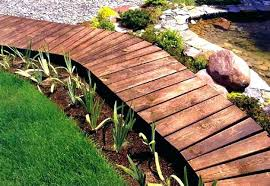 a wooden walkway makes an attractive and inexpensive garden path for some ideas look here