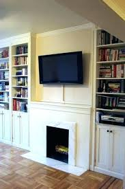hide a tv above fireplace covering hole over