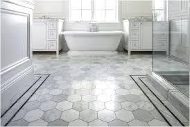 vinyl bathroom floor with hexagon tile pattern by amtico flooring set with white bathtub and bathroom vanity also glass door shower room