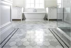vinyl bathroom floor with hexagon tile pattern by amtico flooring set with white bathtub and bathroom vanity also glass door shower room