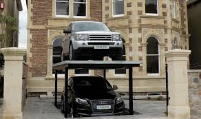 with e at a premium wealthy inner city londoners are converting their driveways into cavernous underground carparks thanks to a swiss pany called