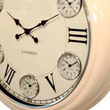 side view of timezone wall clock with cream metal case cream dial with black roman