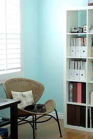 Turquoise blue paint wall color! Turquoise blue pink tan office space.
