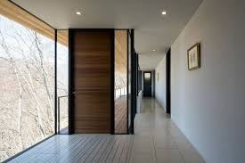 modern wooden door designs for houses. This Modern Front Door With A Horizontal Wood Pattern Is Surrounded By Windows That Look Out At The Trees Surrounding Home. Wooden Designs For Houses S