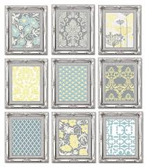 gallery wall art arrangement in grey blue and yellow