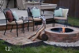 Outstanding Brick Fire Pit Ideas With Black Iron Chairs And Pillows As Well  As Green Garden As Decorate Backyard Patio Decks Ideas