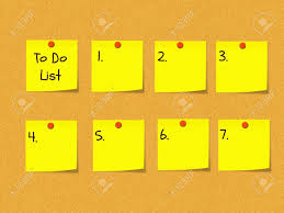 to do lis a to do list on a peg bulletin board with yellow sticky notes