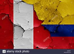 flags of Peru and Colombia painted on brick wall Stock Photo - Alamy