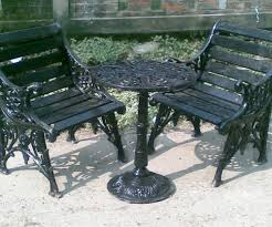 i e black cast iron chair with table
