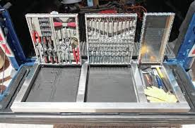 truck bed wheel well tool box. tool box in the truck bed door wheel well
