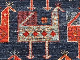birds are a frequent motif in tribal style rugs