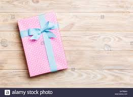 Beautiful Gift Box Design Beautiful Gift Box With A Colored Bow On The Yellow Wooden