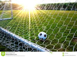 grass soccer field with goal. A Soccer Ball In Grass Field With Goal R