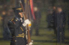 a reflection of one of the honor guard members on hand tuesday march 29 2016 for the wreath laying ceremony to commemorate the 50th anniversary of the