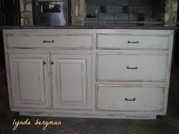 lynda bergman decorative artisan white kitchen cabinets to a hand painted stained wood look and white distressed kitchen island