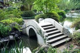 small wooden garden bridge small garden bridge the ornate swirls of stone along this arched stone small wooden garden bridge