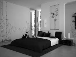 bedroom black and white bedding on the black rug plus black wooden side table plus