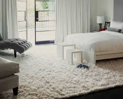 fantastic bedroom interior design with large bed also chairs plus white rug