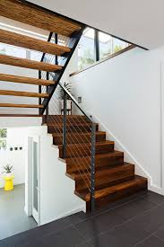 painting stair treads staircase contemporary with walnut floor glass railing