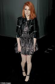 Rock chick: Nicola Roberts looked stylish and sexy in a leather jacket and  short grey