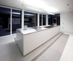 interesting kitchen in minimalist design with metalic countertop island and modern lighting fixtures