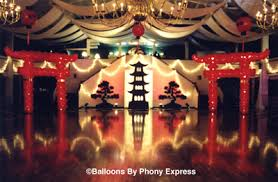 A view of the dance floor and entry with tall Torii gates, our pagoda and  bonsai tree silhouettes, and Oriental lanterns overhead.