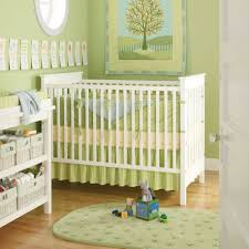 modest green themed baby girl or boy nursery interior idea with white modern crib bedding with bows